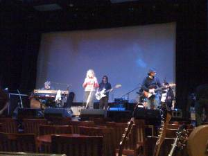 joan and band onstage during soundcheck
